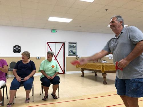 Members of Senior Connection enjoy a game of bean bag baseball each Friday at 10:00 a.m. Each week, the winning team has a group picture taken.